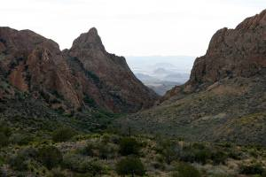 View of the distant desert through the gap in the Chisos Mountains along the Window Trail